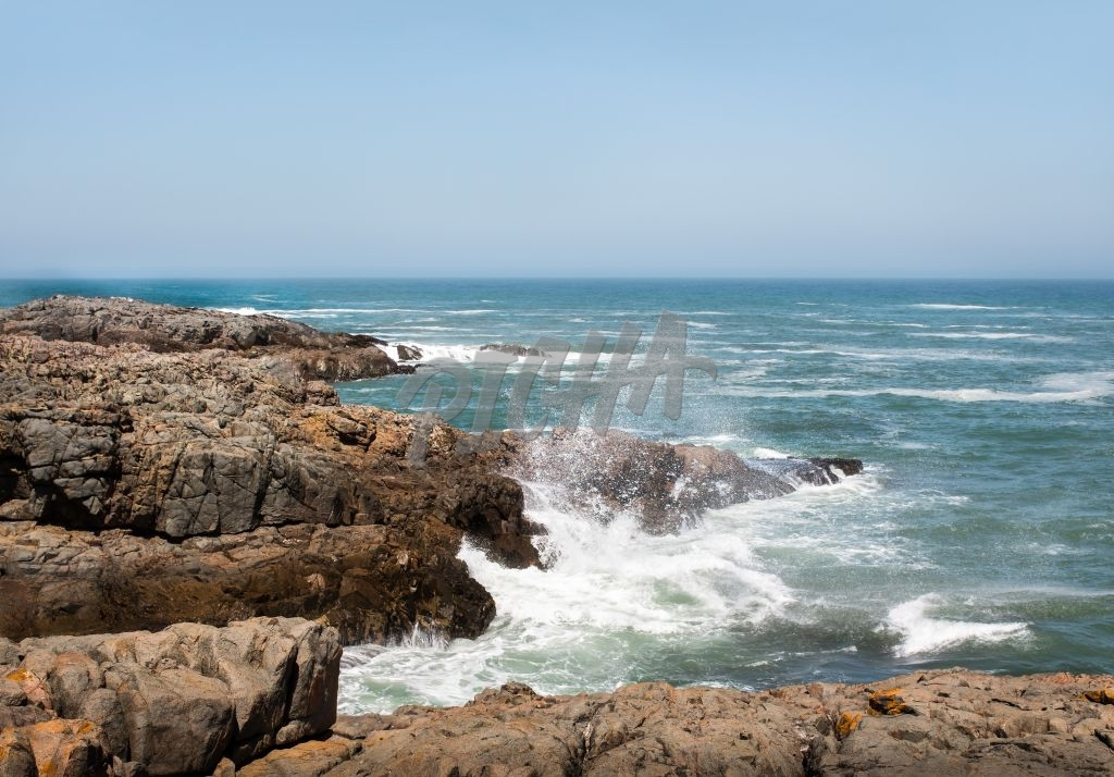Ocean view with rocks in foreground