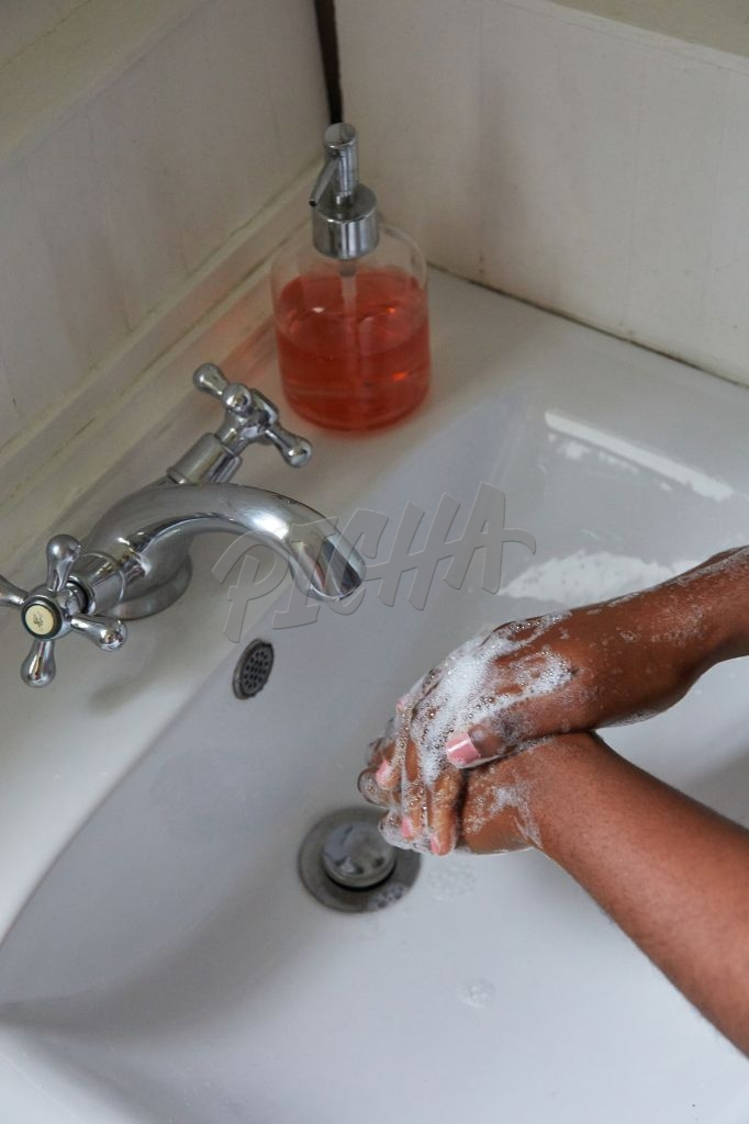 Close up of woman washing hands in bathroom