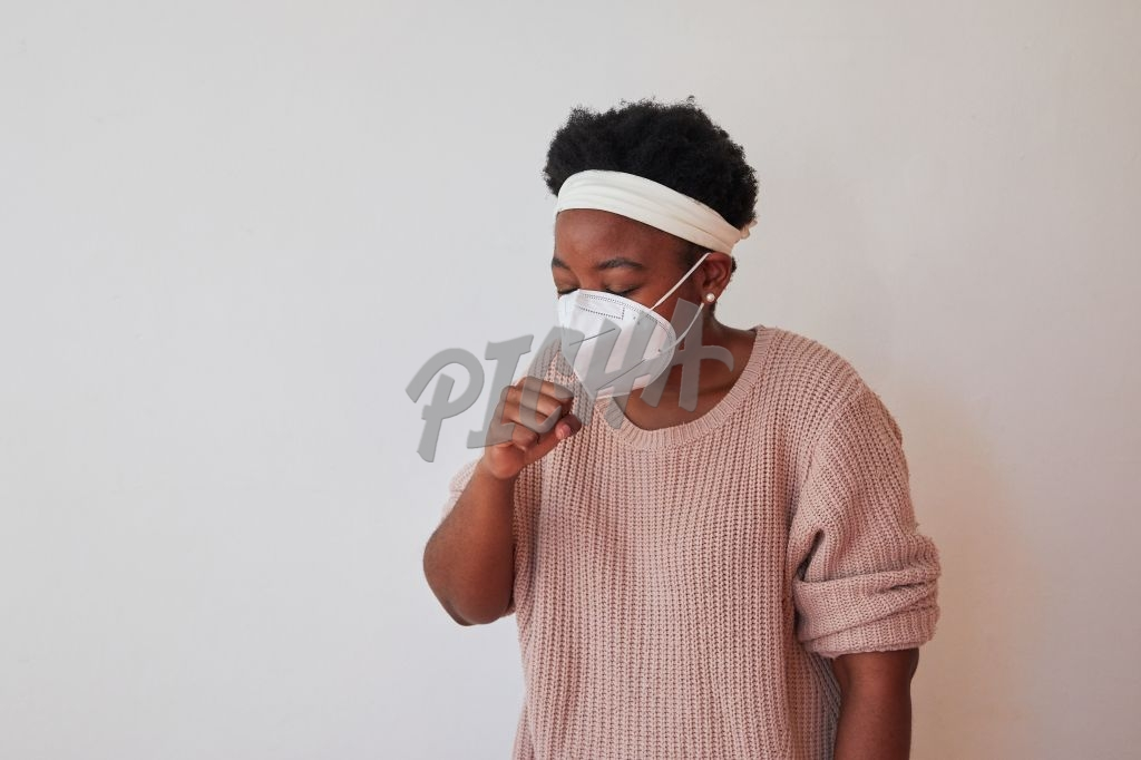 Coughing under a face mask