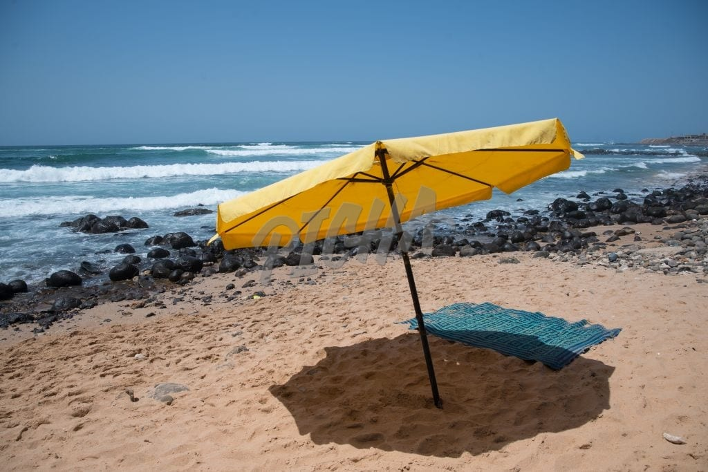 Yellow umbrella on the beach