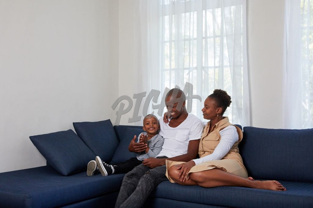 Family sitting in the couch