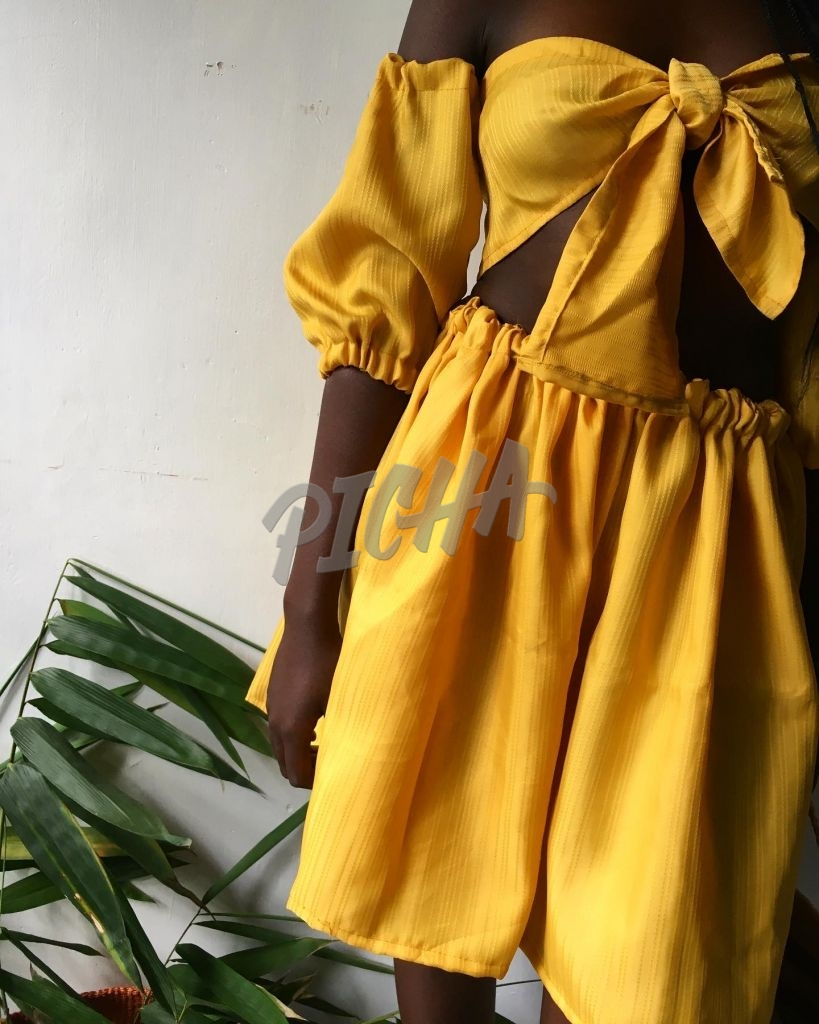 African girl in mustard set