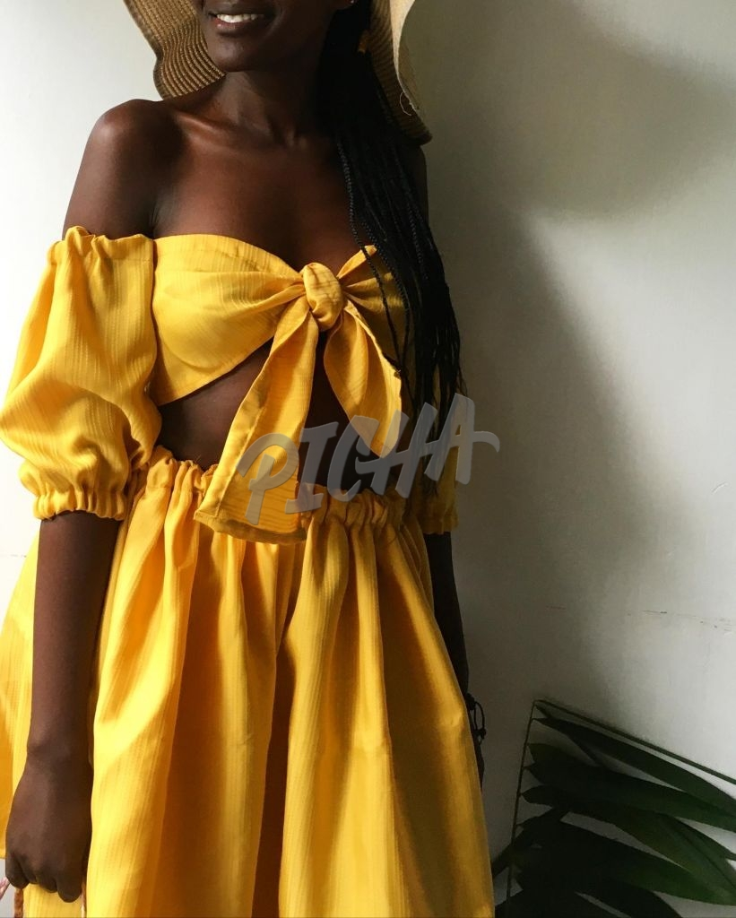 lady in mustard two piece