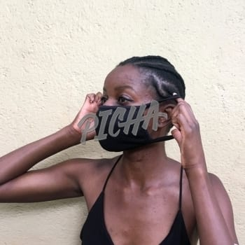 Woman putting on black face mask