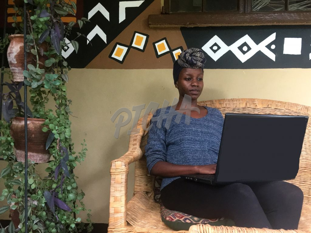 woman working with computer on lap