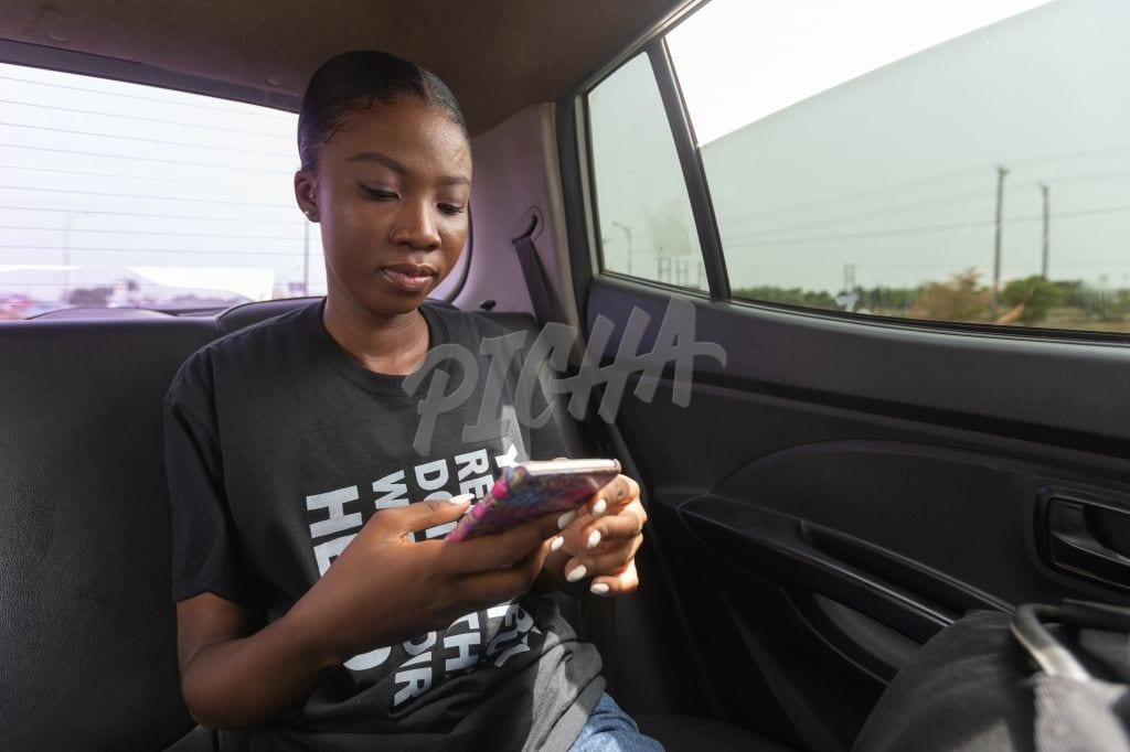 Texting in the backseat