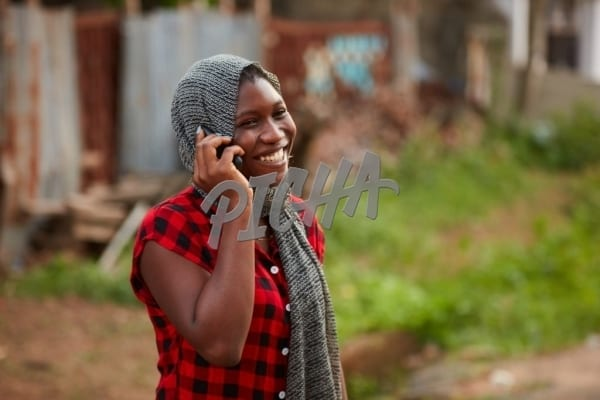 Laughing on a phone call