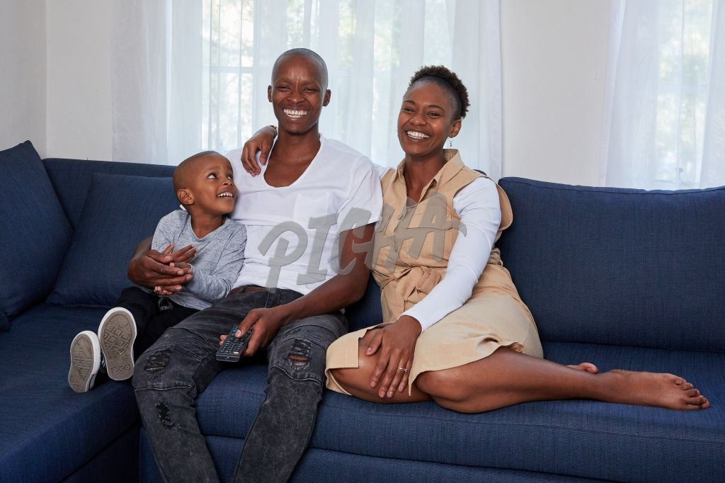 Happy family watching a movie on the couch