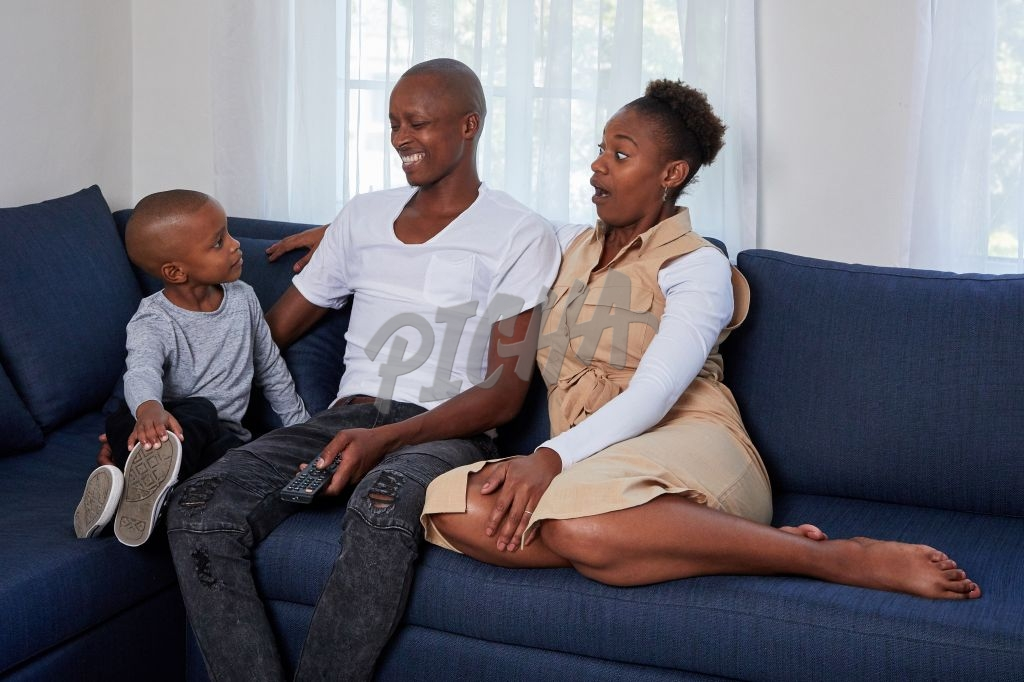 Family watching a movie on the couch