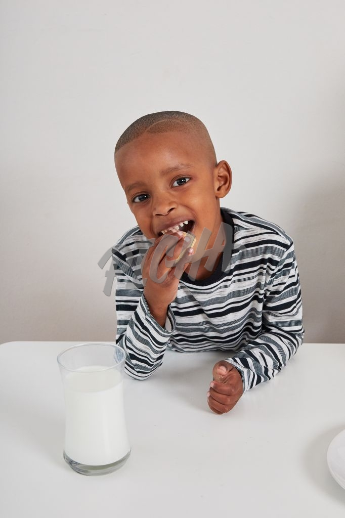 Boy eating a biscuit