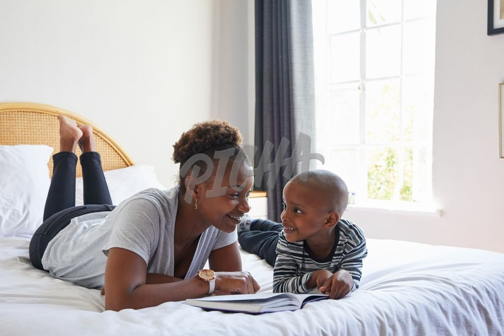 Mother and son reading on bed