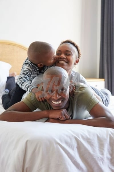 Happy family embracing on bed