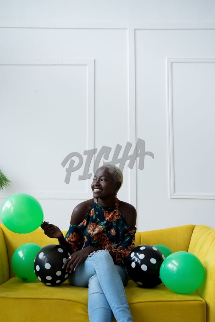 Seated with balloons