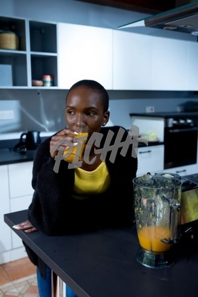 woman drinking a smoothie