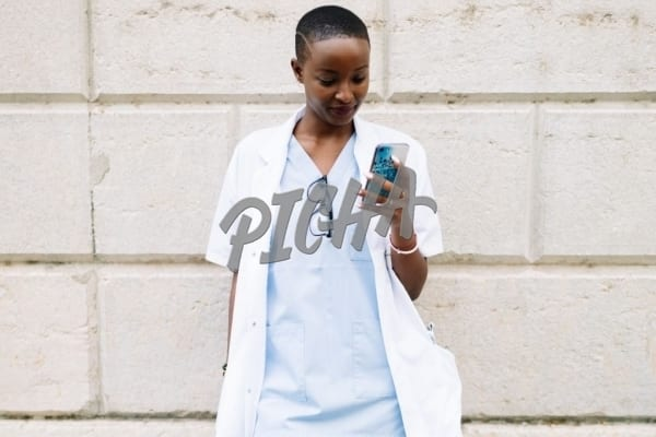 Medical worker checking phone