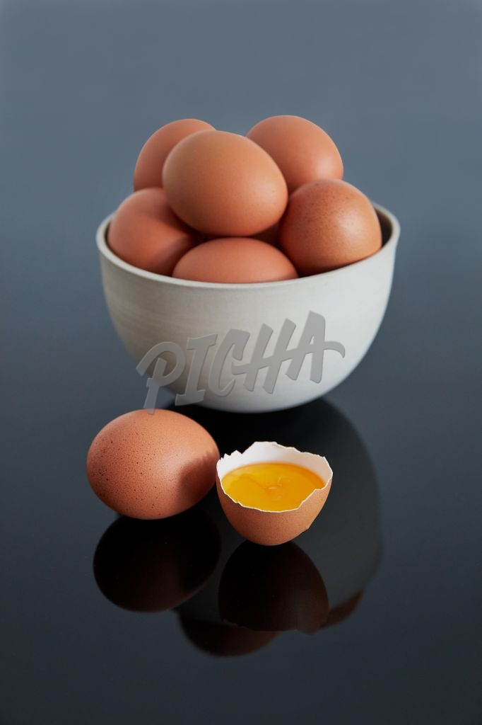 Eggs in a bowl on a dark background
