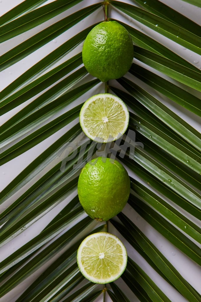 Limes on palm leaf