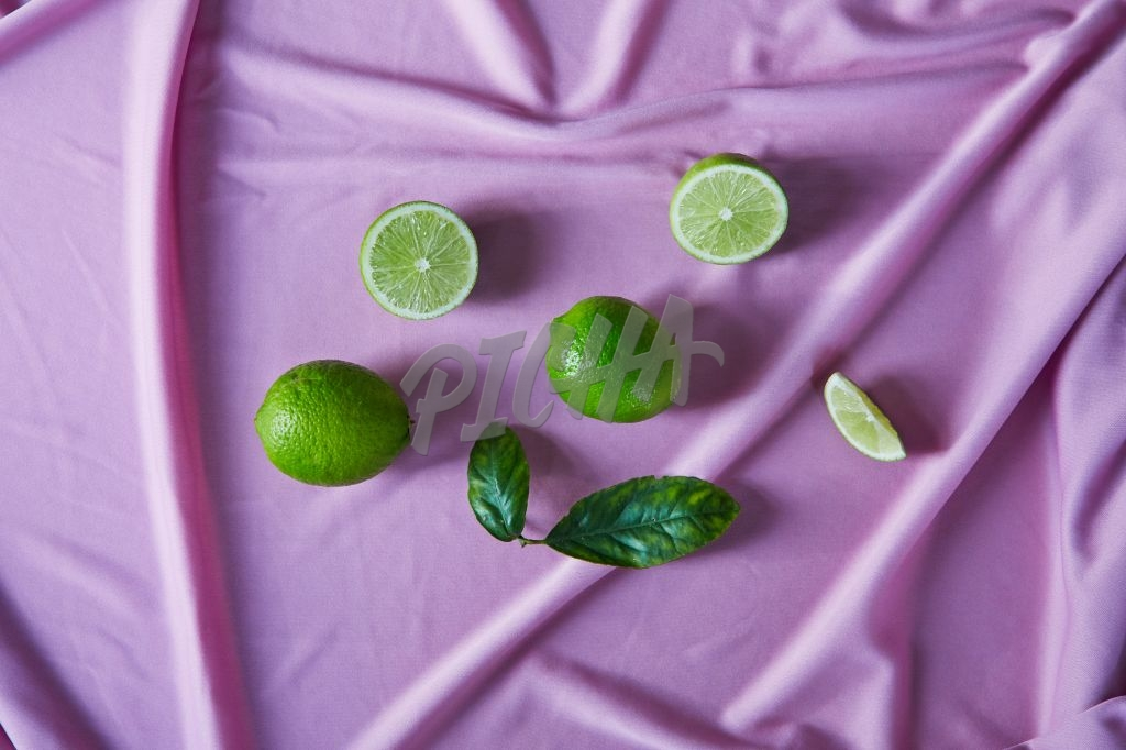 Limes on pink fabric