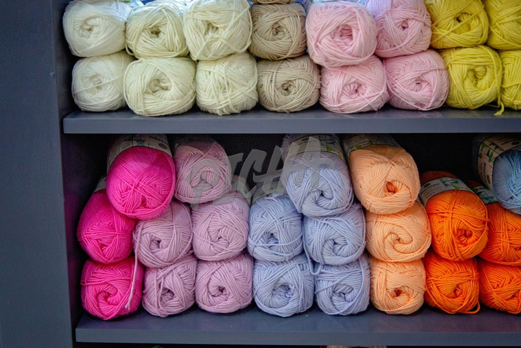 Bundles of wool on a shelf