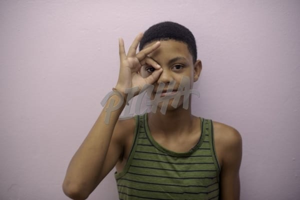 Young boy making a gesture with his fingers