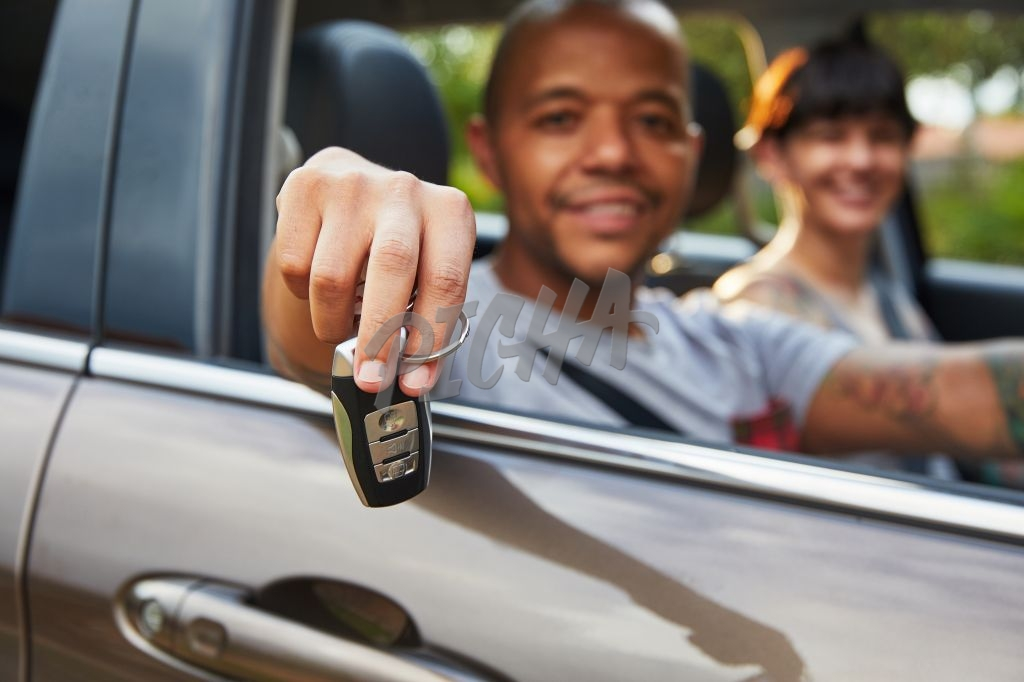 Man holding car key in hand