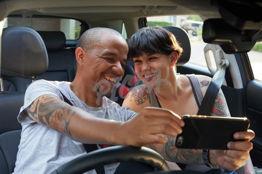 Couple taking a selfie in the car