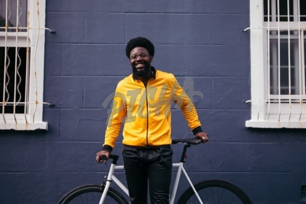 Happy hipster with a bike