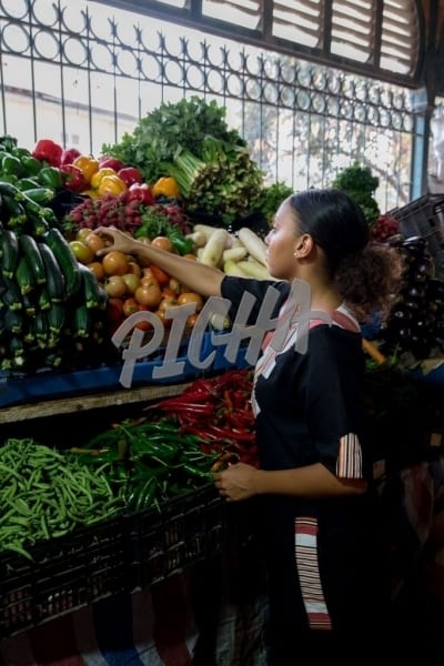 Woman selecting produce