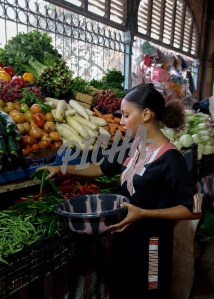 Woman picking a handful of vegetables