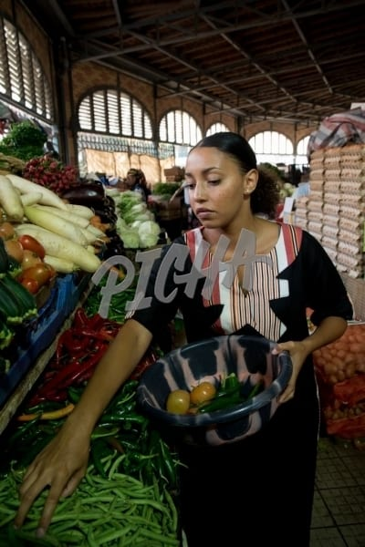 Woman picking vegetables at the market