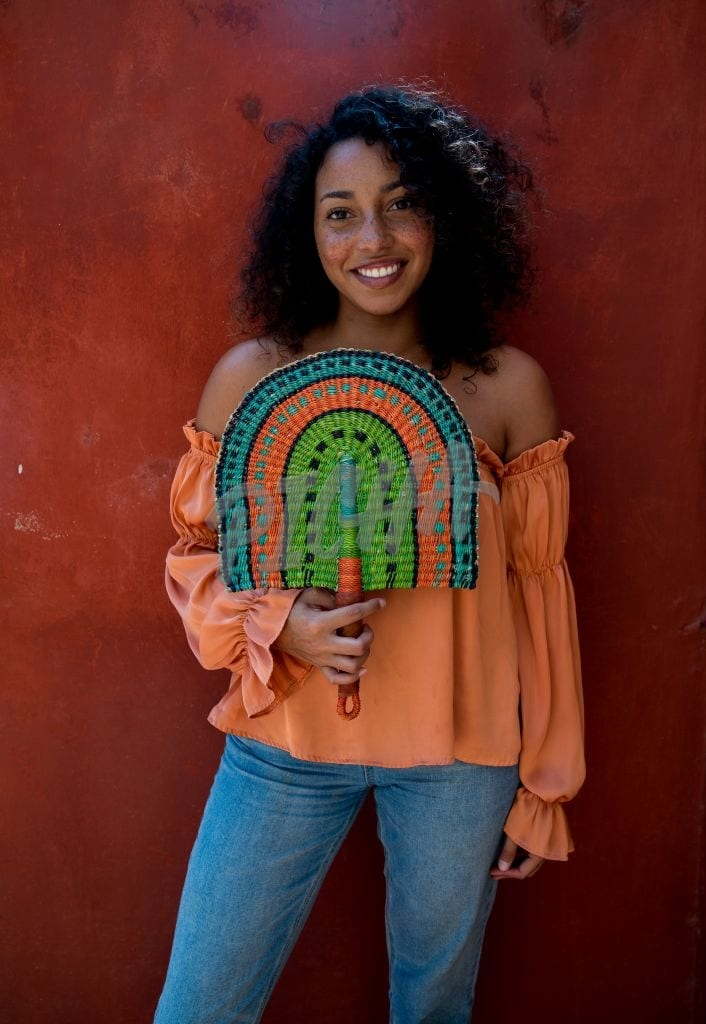 Holding a traditional fan