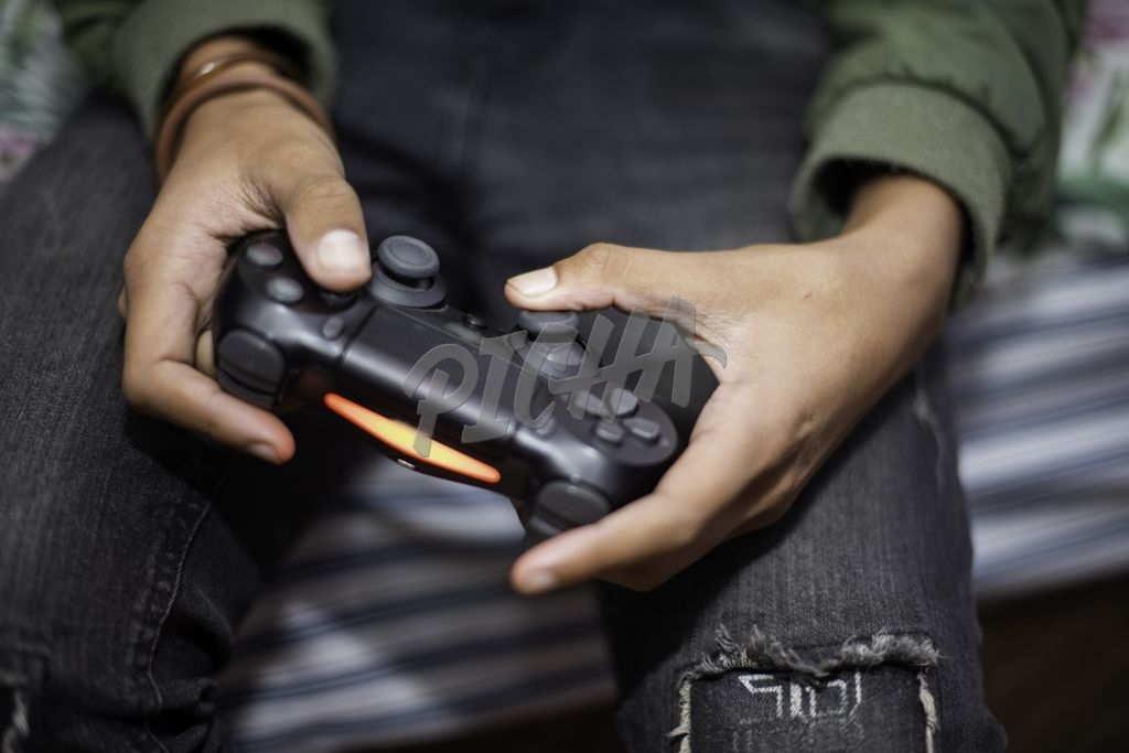 Close up of youngster playing video games