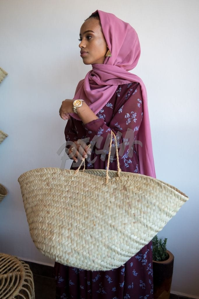 woman carrying a basket