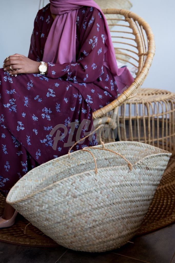 Woman sitting next to a basket