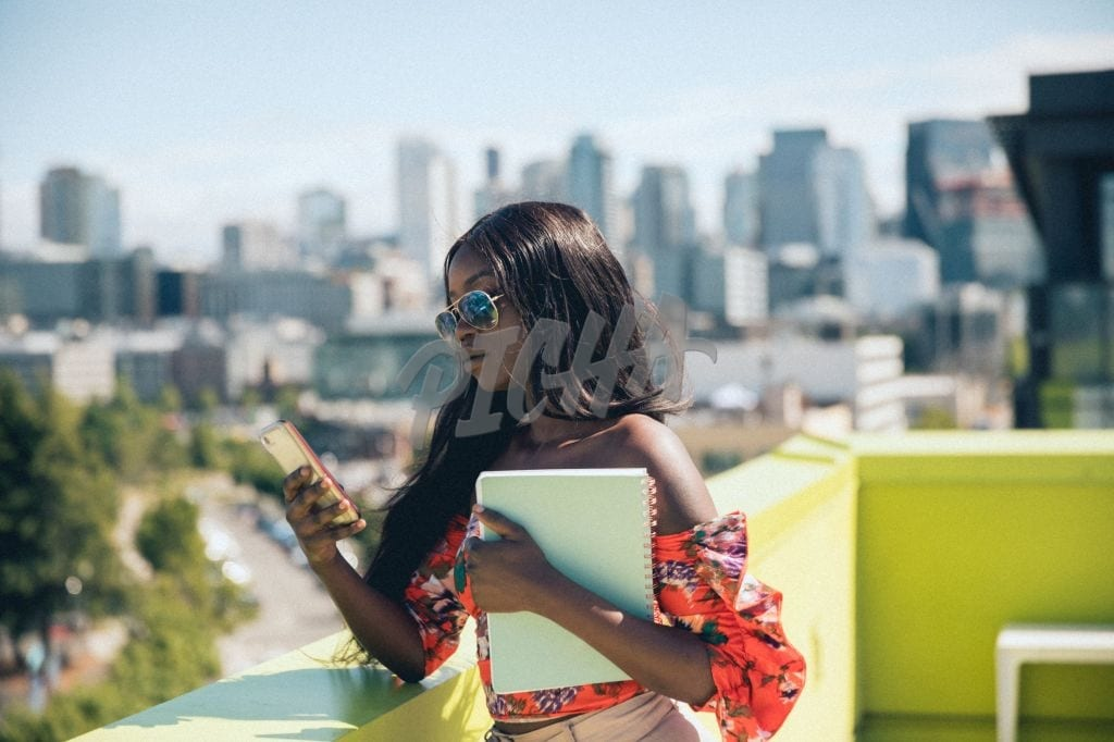 Texting on a rooftop