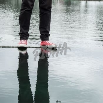 A mans legs floating on a water body