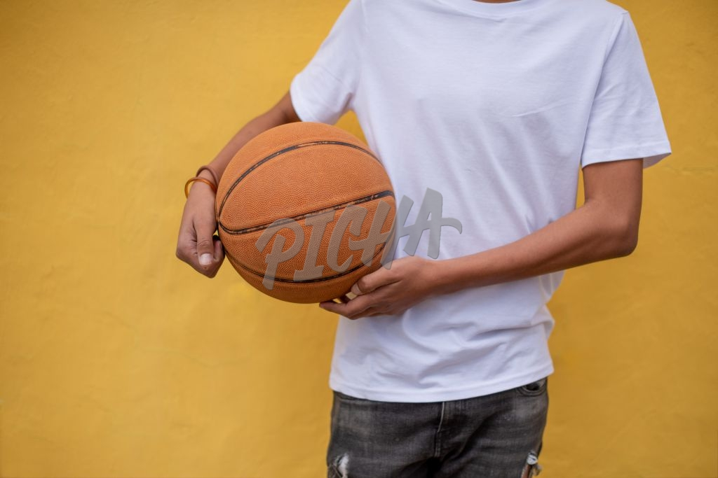 Cropped shot of young boy holding basketball