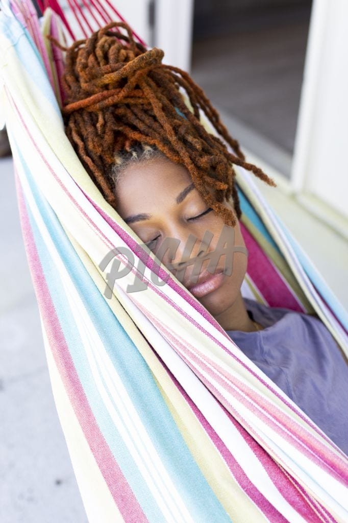 Lady sleeping in a hammock