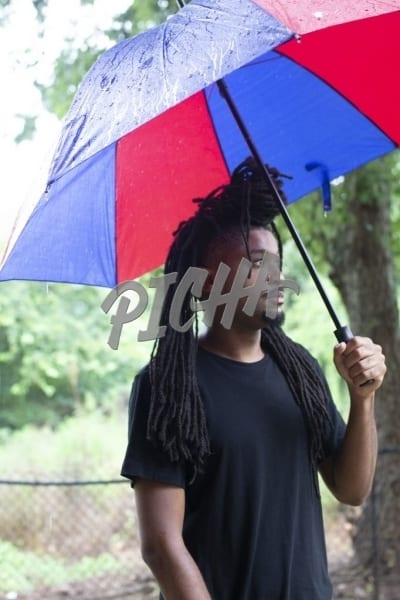 young man in the rain