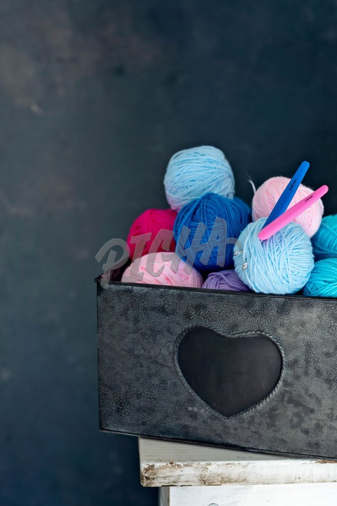 box of woolen balls
