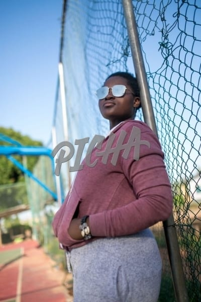 Leaning on a chain link fence