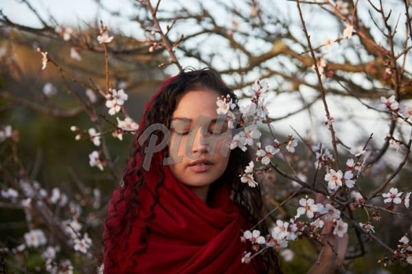 Beautiful woman with cherry blossom