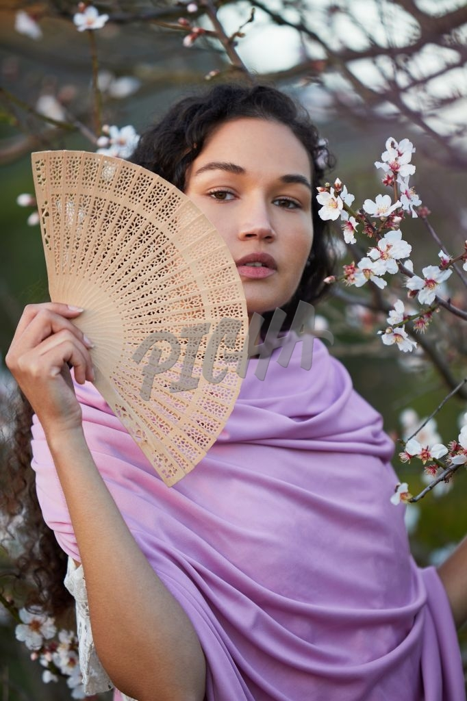 Portrait of a woman with fan
