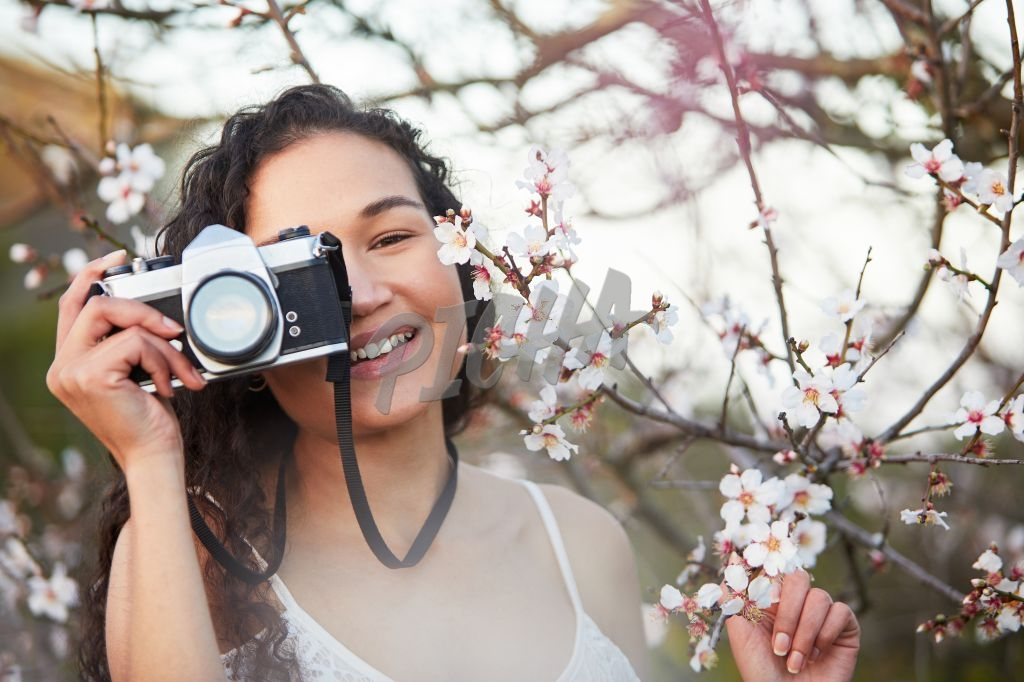 Happy woman with film camera
