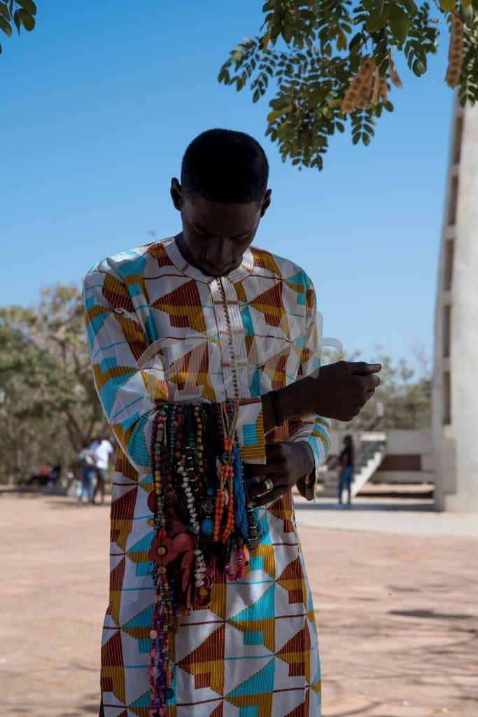 young man selling jewelry