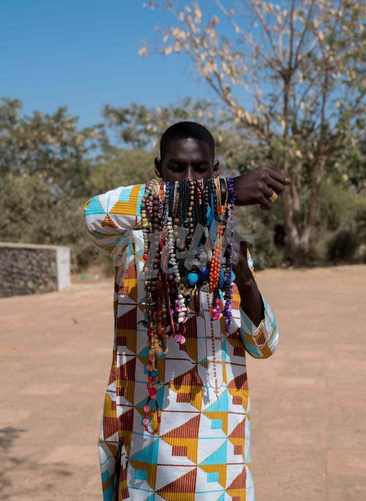 young male selling jewelry