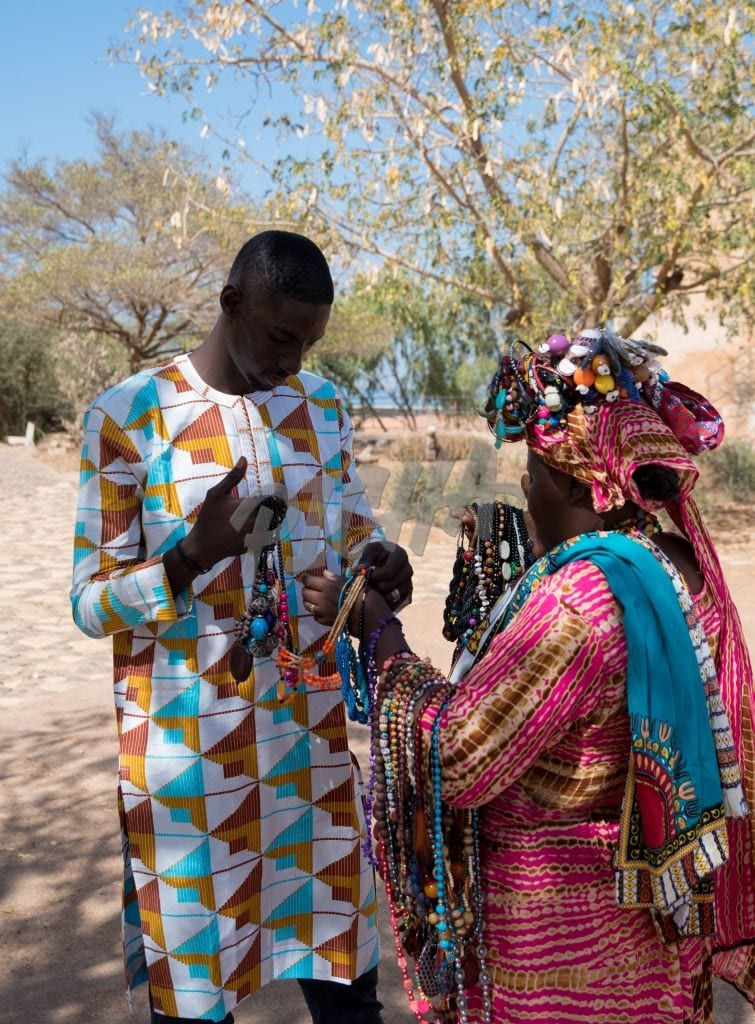 young man selling jewelry to a woman