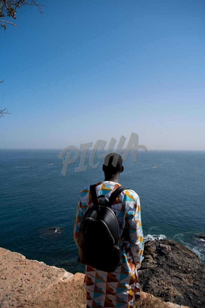 man looking at the ocean