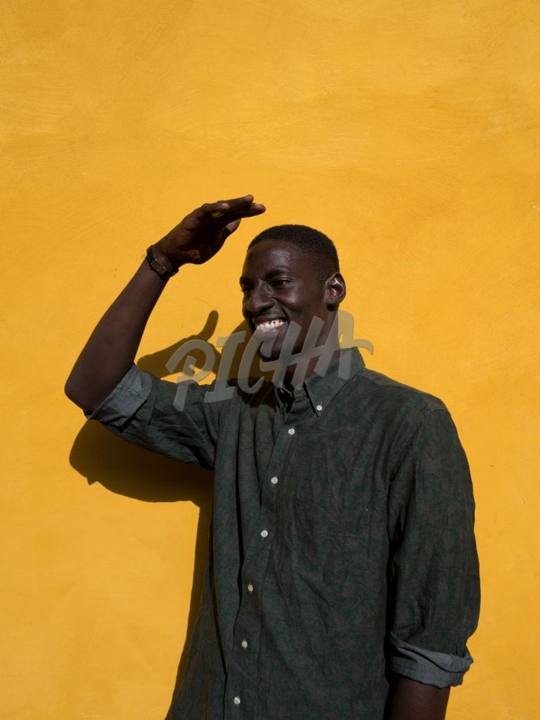 Man against a yellow wall