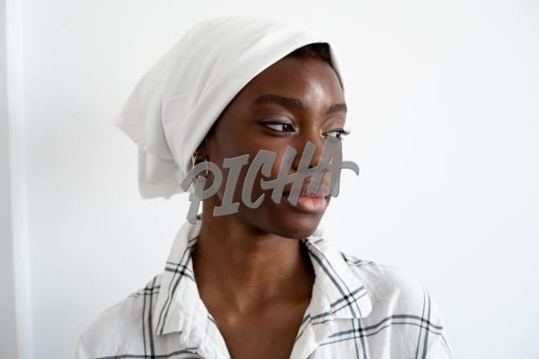 Wearing a white head scarf